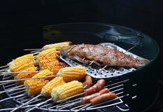 Picnic Time. It's picnic and barbecue time, with grilled sweet corm, grilled fish and hotdogs Royalty Free Stock Images