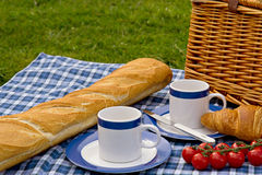 Picnic for two. Picnic basket for two outsite Royalty Free Stock Photography