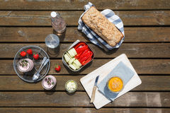 Picnic with wholemeal-wheat-spelt-bread, dips, crudites. Strawberry-yogurt and lemonade Royalty Free Stock Photography