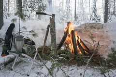 On a picnic in the woods near the fire in winter. Royalty Free Stock Images
