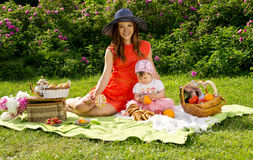 Picnic, a young mother with a baby Royalty Free Stock Photography