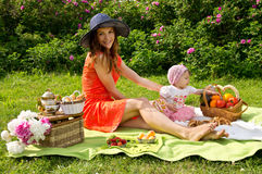 Picnic, a young mother with her daughter Stock Photography