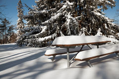 The picnictable under deep layer of snow in the park Stock Photo
