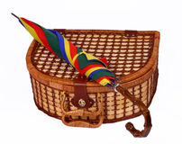 Picninc basket with a colorful umbrella on top. Picninc wicker basket with a colorful umbrella on top Royalty Free Stock Photography