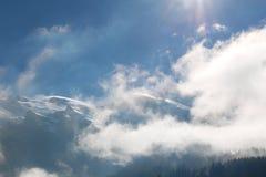 Pico con las nubes Foto de archivo