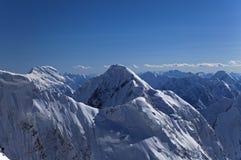 Pico de Chapayev e pico de Pobeda, montanhas de Tian Shan Foto de Stock Royalty Free