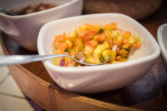 Pico de gallo. In a bowl in a restaurant setting royalty free stock photography