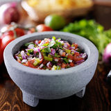 Pico de gallo salsa. In traditional mexican stone molcajete royalty free stock image