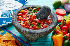 Pico de Gallo sauce from Mexico in molcajete. Pico de Gallo sauce from Mexico with tomato cilantro and onion in molcajete royalty free stock photography