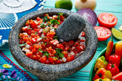 Pico de Gallo sauce from Mexico in molcajete. Pico de Gallo sauce from Mexico with tomato cilantro and onion in molcajete stock photos
