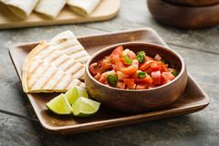 Pico de Gallo. Traditional mexican salsa with tomatoes and chilis royalty free stock photography