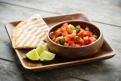 Pico de Gallo. Traditional mexican salsa with tomatoes and chilis royalty free stock photo