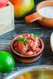 Pico de gio sauce, homemade cooking. Mexican food. Vertical Stock Photo