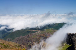 Pico do Areeiro clouds, Madeira. Clouds and fog coming up mountains, valleys and cliffs at Pico do Areeiro. Madeira, Portugal Royalty Free Stock Photography