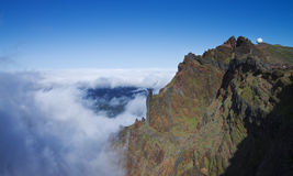 Pico do Areeiro, Madeira. Pico do Areeiro towering over an ocean of clouds. Madeira, Portugal Royalty Free Stock Image