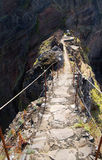 Pico do Areeiro vertigo trail passage, Madeira. A narrow passage along a ridge with high cliffs both sides. Pico do Areeiro to Pico Ruivo hiking trail, Madeira Stock Photos