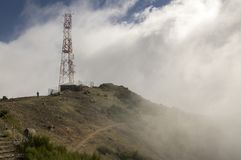 Pico do Arieiro hiking trail, amazing magic landscape with incredible views, rocks and mist, high transmitter station royalty free stock image