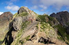 Pico do Arieiro hiking trail, amazing magic landscape with incredible views, rocks and mist. Morning sunlight stock image