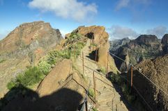 Pico do Arieiro hiking trail, amazing magic landscape with incredible views, rocks and mist. Railing stock photos