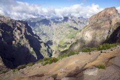 Pico do Arieiro hiking trail, amazing magic landscape with incredible views, rocks and mist, view of the valley between rocks. Madeira Stock Photo