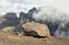 Pico do Arieiro hiking trail, amazing magic landscape with incredible views, rocks and mist, view of the valley between rocks. Big stone Stock Photos