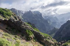 Pico do Arieiro hiking trail, amazing magic landscape with incredible views, rocks and mist, view of the valley between rocks. Amazing views royalty free stock image