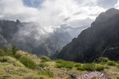 Pico do Arieiro hiking trail, amazing magic landscape with incredible views, rocks and mist, view of the valley between rocks royalty free stock photos