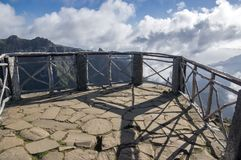 Pico do Arieiro hiking trail, amazing magic landscape with incredible views, rocks and mist, viewpoint. With wooden railing and clouds Royalty Free Stock Photography