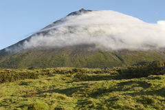 Pico island green landscape with mountain and clouds. Azores. Po Royalty Free Stock Photo