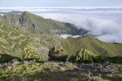 Pico Ruivo hiking, above clouds, amazing magic landscape, incredible views, sunny weather with low clouds, island Madeira, Portu. Gal, breathtaking view royalty free stock photo