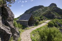 Pico Ruivo hiking, stone shelter, amazing magic landscape, incredible views, sunny weather with low clouds, island Madeira. Portugal, Europe Royalty Free Stock Image