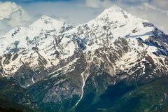 Picos da neve no verão Imagem de Stock