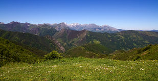 Picos de Europa view from Puerto de Pajares Asturias. Landscape from Puerto Pajares 1378 meters high, showing snow on the top of Europe Peaks in spring, Asturias Royalty Free Stock Image