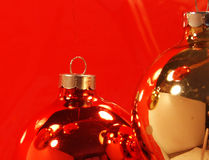 Pict 5386 Red and Gold Christmas Ornaments On Red Background. Red and Gold Christmas ornaments on a red background Royalty Free Stock Photography