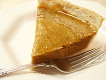 Pict5019 Pumpkin Pie and Fork on White Plate Royalty Free Stock Photo