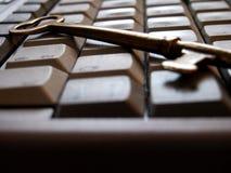 Pict5287 Skeleton Key on Computer Keyboard. Old brass skeleton key on top of a laptop computer keyboard Royalty Free Stock Photo