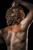 Pictish warrior covered in mud and naked, detail muscle Royalty Free Stock Images