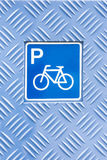 Pictogram, bicycle parking. Placed in an aluminium panel Stock Images
