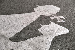 Pictogram: girl and boy. Pictogram on road surface: girl and Boy Stock Images