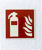 Pictogram for hand-held extinguisher. On a white wall Stock Photography