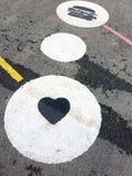 Pictogramas en el asfalto Fotografía de archivo libre de regalías