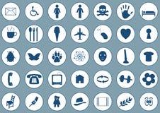 Pictogrammen op blauw Royalty-vrije Stock Afbeeldingen