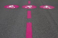 Pictograms bike skate run. Pink pictograms of biker, skater, jogger on grey surface Stock Photography