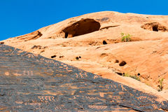 Pictographs and Cave. Ancient Pictographs by a cave at The Valley of Fire State Park outside of Las Vegas Nevada Stock Photography
