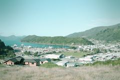 Picton, New Zealand. Townscape of Picton and Marlborough Sounds, New Zealand. Famous harbor town. Cross processed color tone - retro filtered style Stock Images