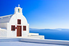 Pictoresque Church, Santorini. A small church or chapel perched on a cliff edge in the town of Oia with a stunning view of the caldera, Santorini, Greece Royalty Free Stock Image