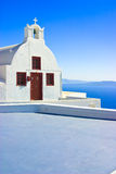 Pictoresque Church, Santorini. A small church or chapel perched on a cliff edge in the town of Oia with a stunning view of the caldera, Santorini, Greece Stock Photography