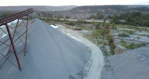 Pictorial abandoned mining sector with white bags clusters. Pictorial abandoned mining sector with white full bags clusters against green forests and meadows stock video