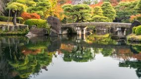 Pictorial autumn scene at Koko-en Gardens in Himeji, Japan. Pictorial scene at Koko-en Gardens in Himeji, Japan with the classical bridge over the pond and royalty free stock photography