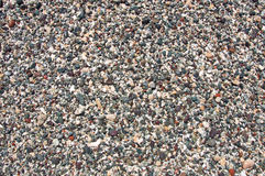 Pictorial background of colorful fine grains of pebbles Royalty Free Stock Photography